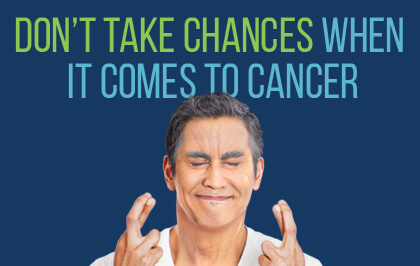 Man crossing fingers hoping not to get colorectal cancer
